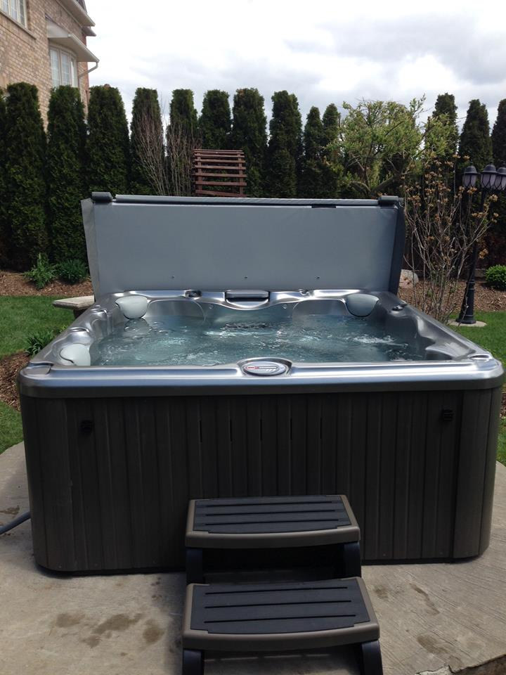 Backyard hot tub and spa installation 53