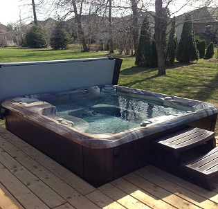 Outdoor backyard hot tub and spa installation 8